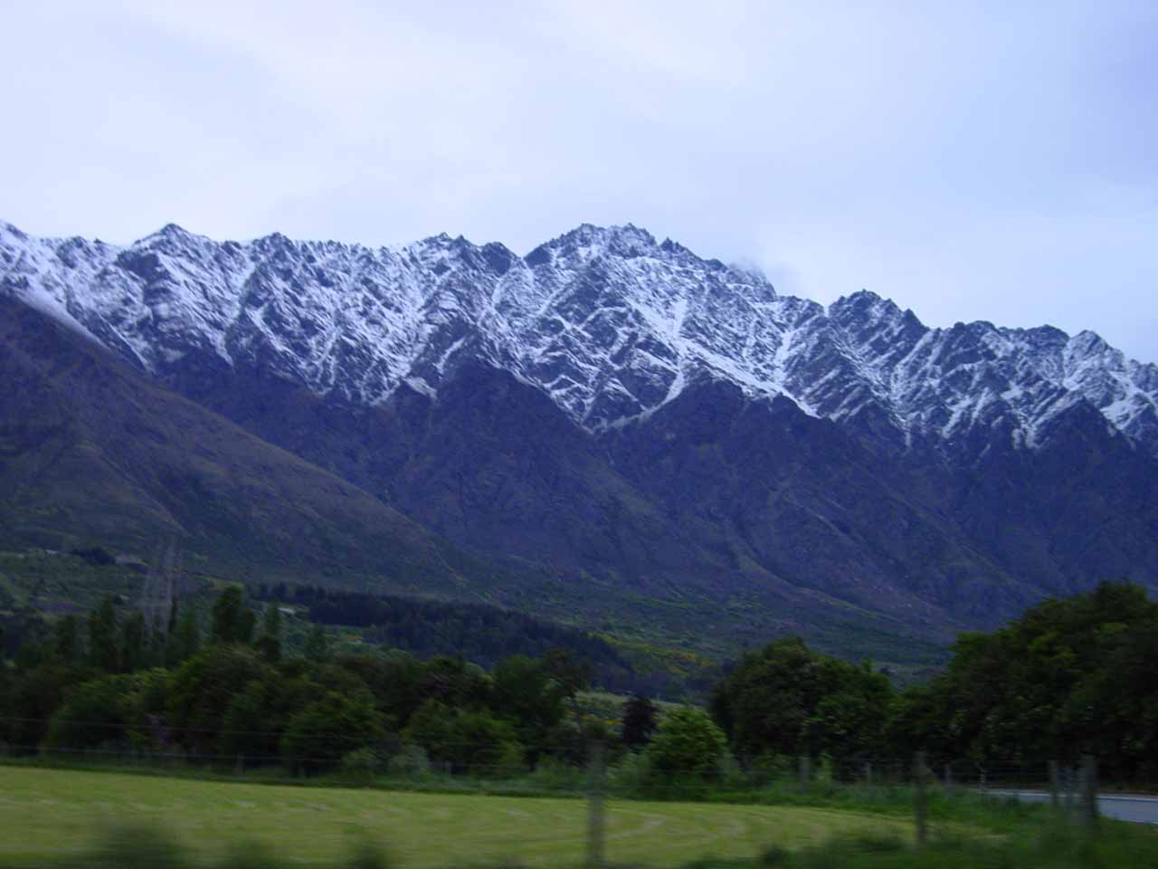 Looking towards the Remarkables while driving out of Queenstown