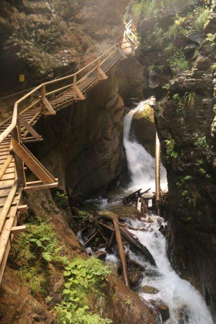 Raggaschlucht_137_07132018 - Context of the boardwalk hugging cliffs above intermediate waterfalls within in the Ragaschlucht Gorge