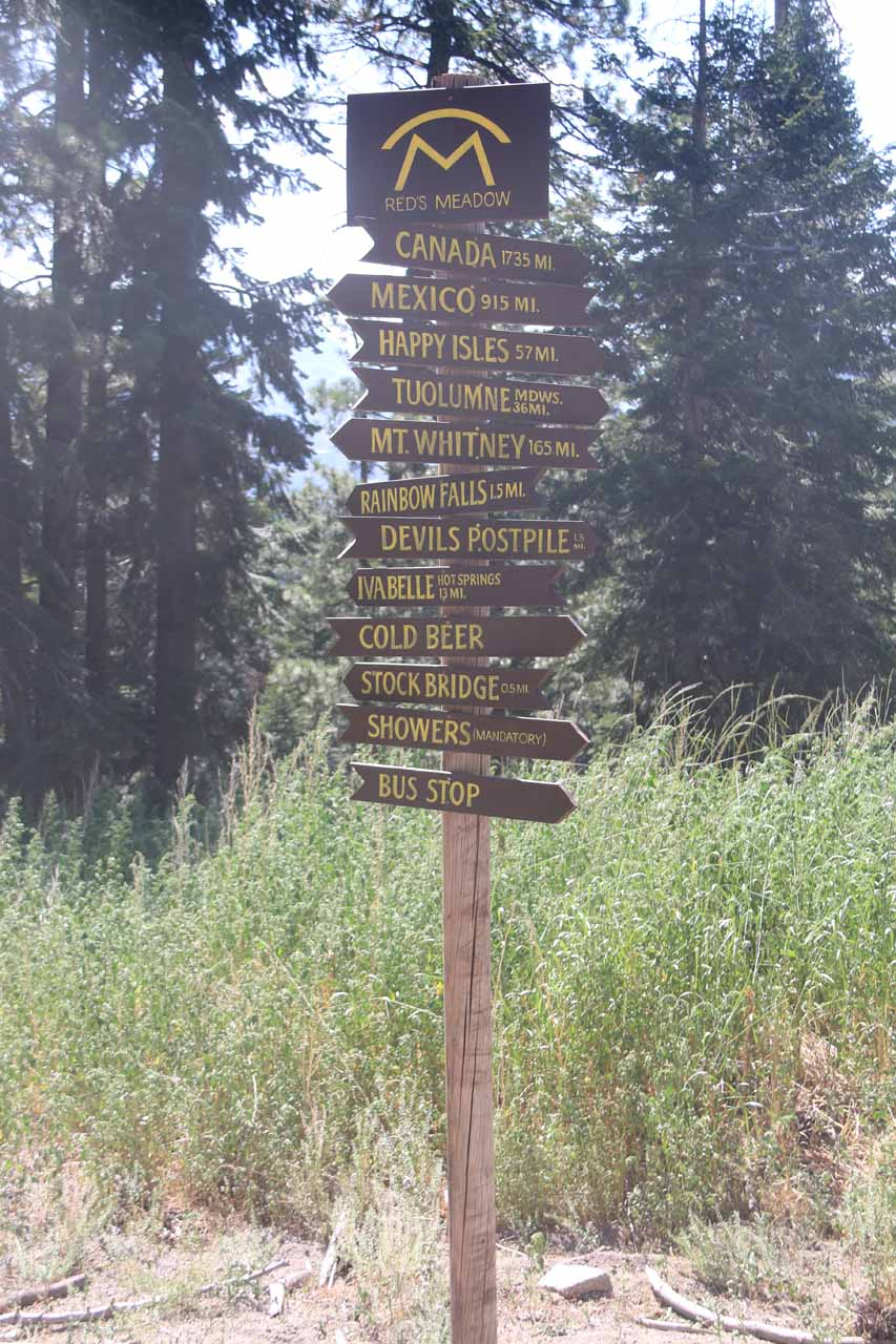 A directional sign showing all sorts of landmarks pointing away from Red's Meadow