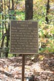 Raven_Cliff_Falls_012_20121017 - Looking at a sign explaining how the Mills and Moore Families had protected and shared the Raven Cliff Falls for citizens of South Carolina