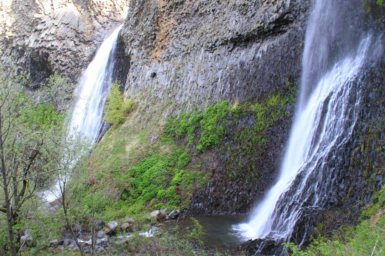 Pair of waterfalls comprising Cascade du Ray-Pic separated by cliffs of basalt as seen from the forbidden base