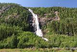 Reiarsfossen_018_07252019 - Broad view from the Reiårsfossen Camping of the waterfall towering over Rv9 as seen during our visit in July 2019