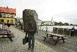 Reykjavik_Old_Harbor_070_08192021 - Closeup look at the faceless bureaucrat statue in the center of Reykjavik