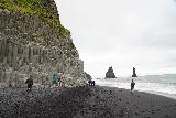 Reynisfjara_035_08072021 - Context of the Reynisfjara basalt columns and the Reynisdrangar spires in the background as seen from the black sand beach