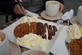 Reynisfjara_084_08072021 - Digging into one of the waffles we got at the cafe at Reynisfjara Beach