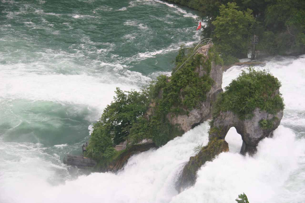 View of a natural arch within Rhine Falls as seen from Schloss Laufen
