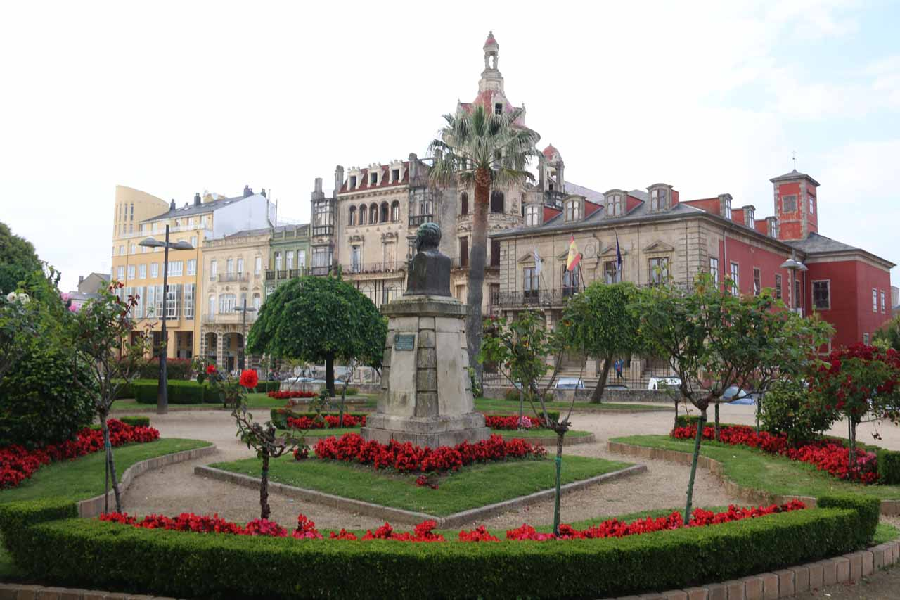 Looking across the park at the center of town towards some old buildings in Ribadeo