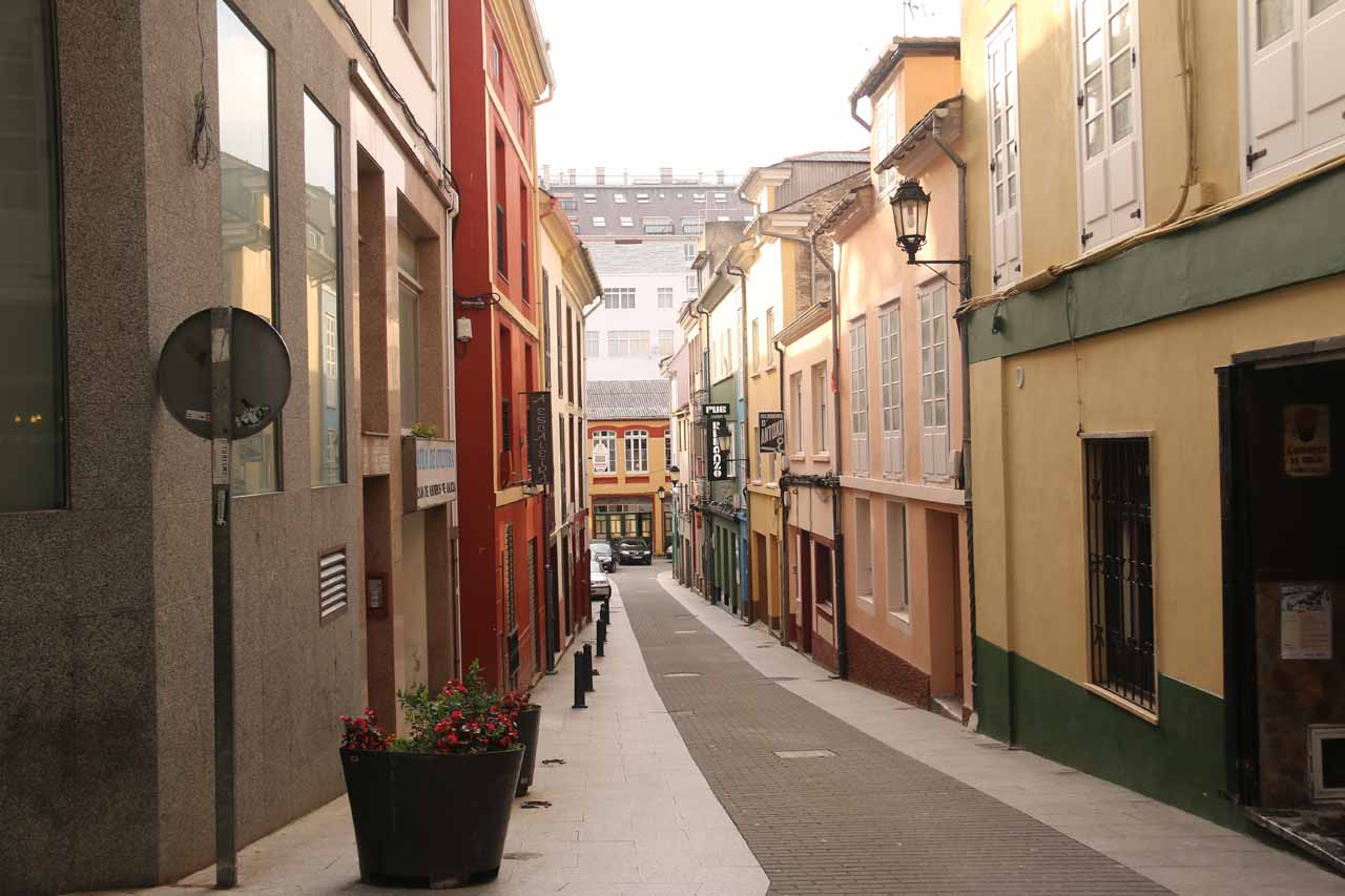 Looking down another quiet arcade in downtown Ribadeo