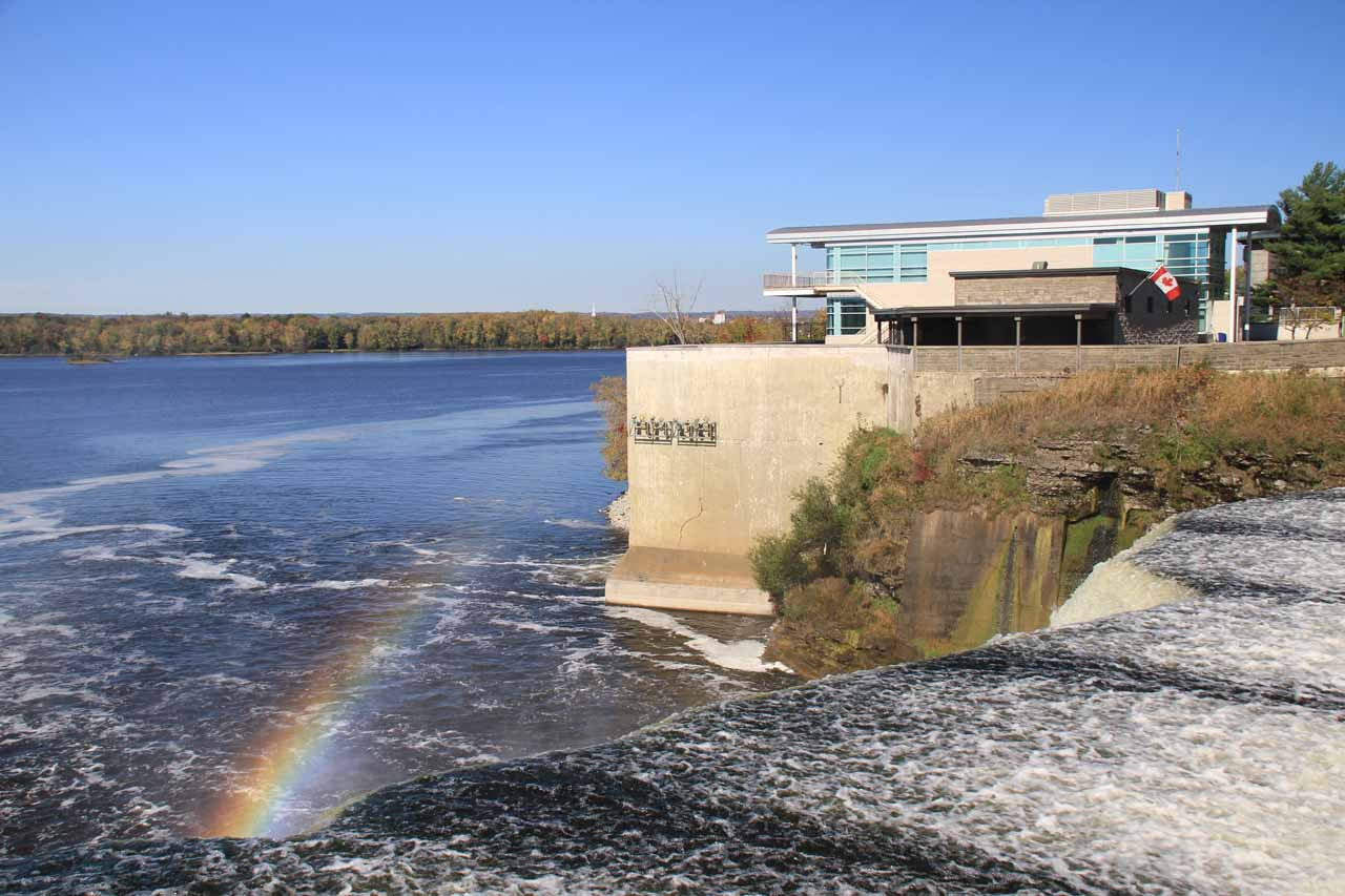 Looking back across the first of two Rideau Falls with a rainbow in its mist