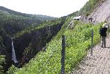 Rjukan_117_06192019 - Context of Julie checking out Rjukanfossen from the footpath alongside the rim of its gorge outside the Maristitunnelen on our June 2019 visit