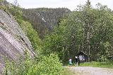 Rjukan_119_06192019 - Julie and Tahia starting to head back to the trailhead to end our Rjukanfossen visit in June 2019. The waterfall ahead of them might be the Våeråifossen