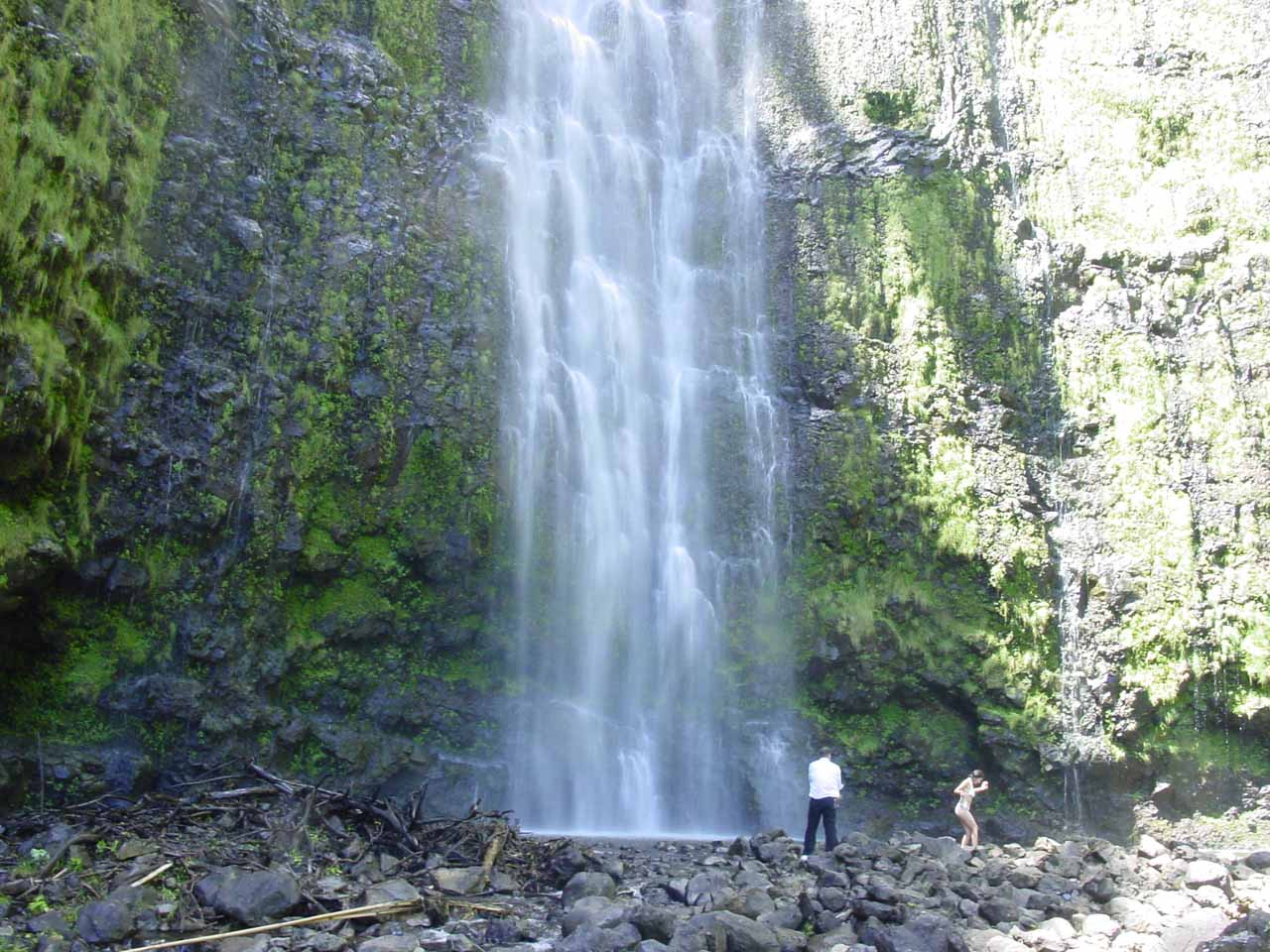 Some folks choosing to get wet beneath the falls despite Mother Nature telling them they're doing so at their own risk