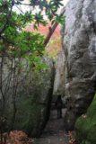 Rock_City_011_20121026 - Julie going through a narrow corridor as part of the Enchanted Trail through Rock City