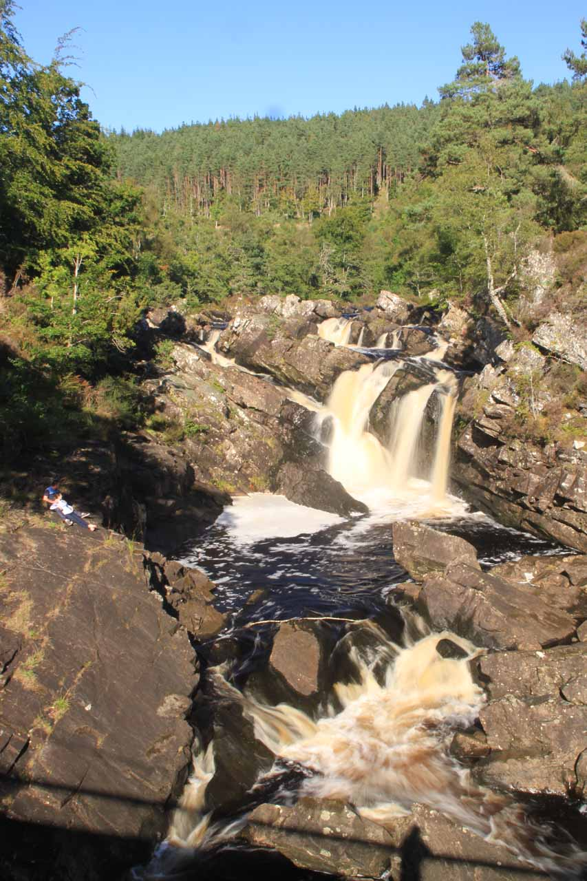 Frontal portrait view of Rogie Falls from the middle of the suspension bridge