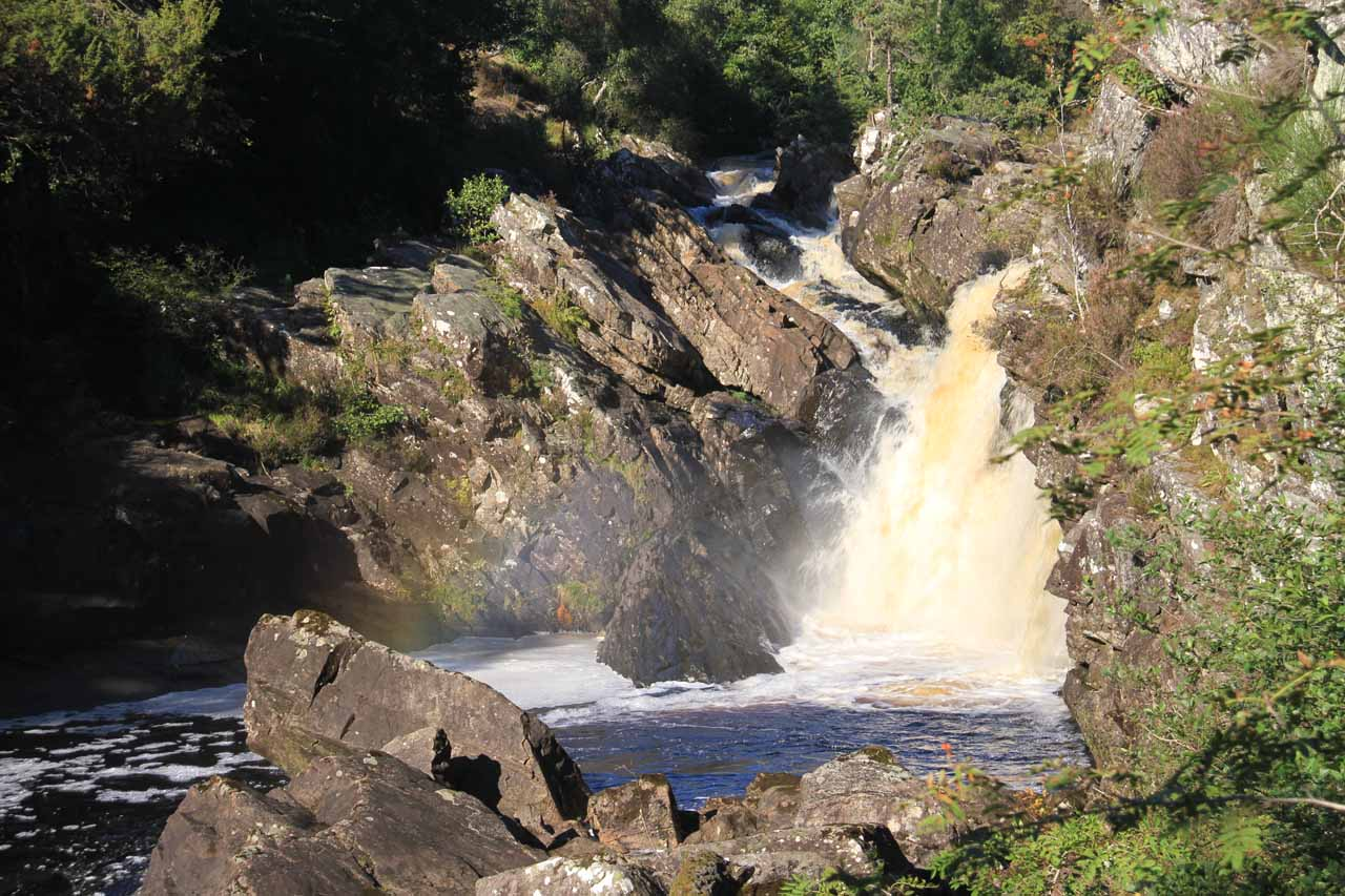 Partial side view of Rogie Falls from the far side of the suspension bridge