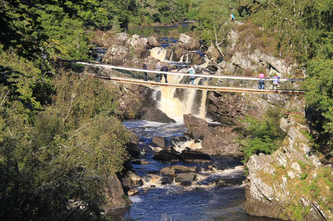 View of Rogie Falls and the suspension bridge from the Raven's Crag Lookout