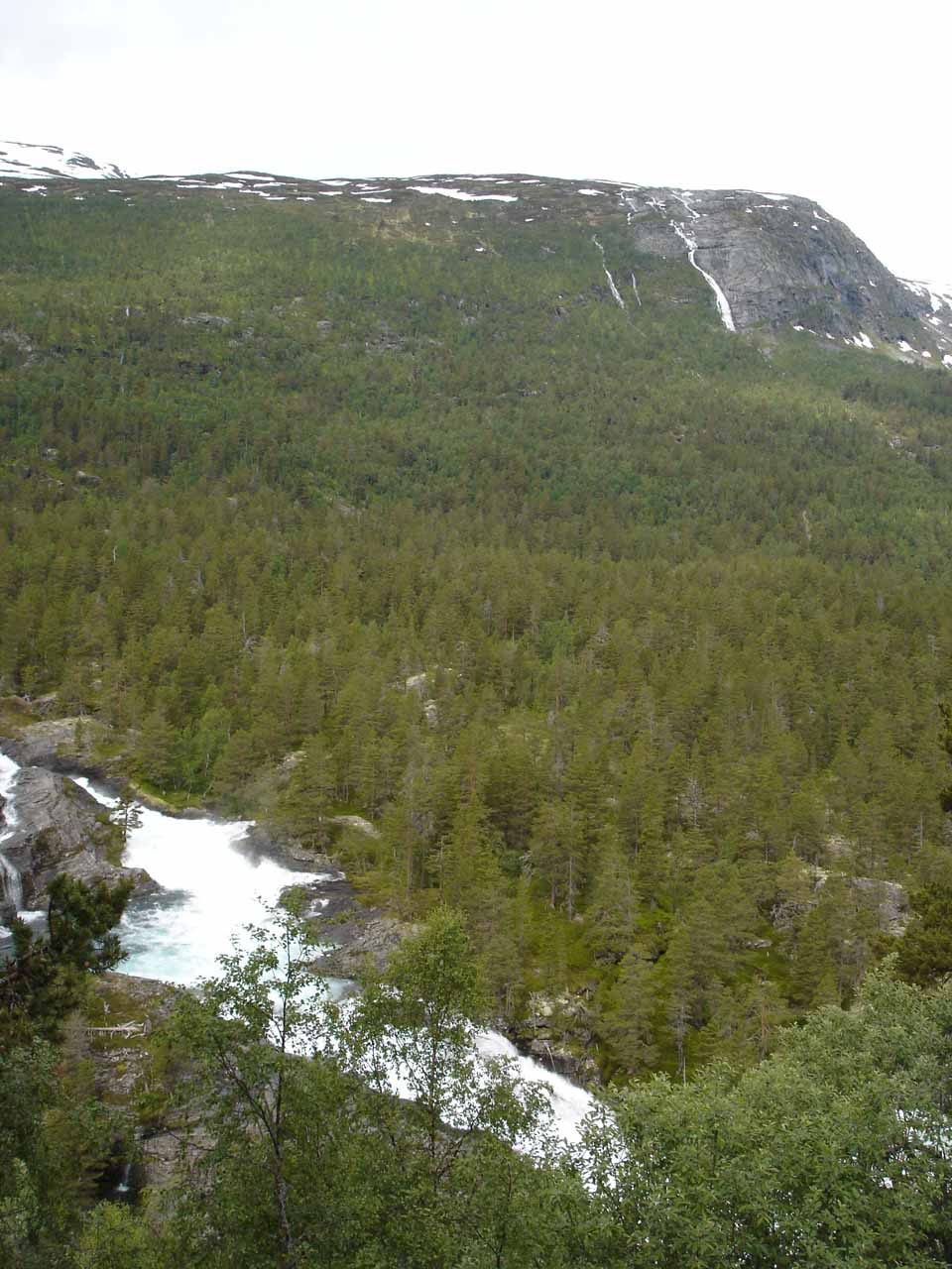 When we backtracked on the E136 now headed southeast, we then found the next pullout where we got this view of Svaåafossen in the distance shortly before scrambling to find a better view of Kleivafossen