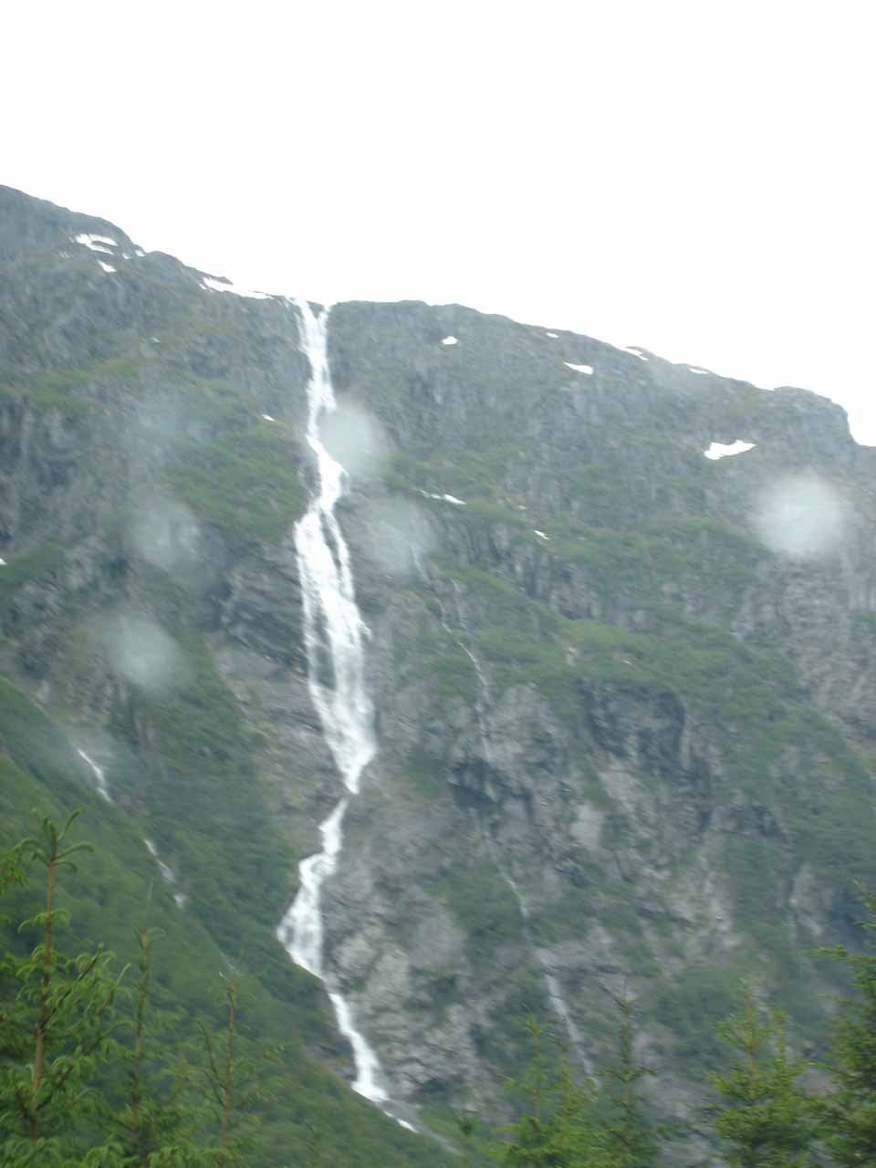 Now looking directly up at Ølmåafossen through some of the rain drops on the window