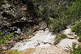 Rubio_Canyon_040_04142020 - Context of one of the water slides on Rubio Canyon Creek with a water pipe above it as seen during the scramble up to the Rubio Canyon Falls