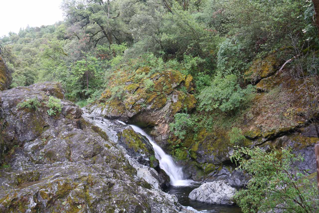 Rush Creek Falls as seen from its sheltered viewing area in the scenic flume section of the South Yuba Independence Trail West