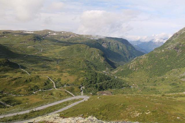 Rv55_085_07212019 - Looking back down at the tight hairpin turns on the way up the Sognefjellsvegen from the lookout where we were able to view the Skautefossen in the distance