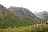 Rv63_Rv15_049_07192019 - Descending the Rv15 while looking towards some farms in the Hjelledalen Valley near the pullout for Øvstefossen