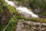 Rv63_Rv15_075_07192019 - Context of more railings of the Øvstefossen Trail with the waterfall itself rushing by