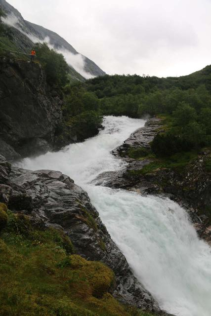 Rv63_Rv15_091_07192019 - Looking back up towards the upper part of Øvstefossen with someone at the main overlook for a little sense of scale