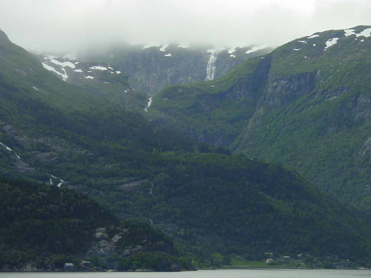 Looking across Sørfjorden somewhere north of Ædnafossen towards a very tall pair of waterfalls