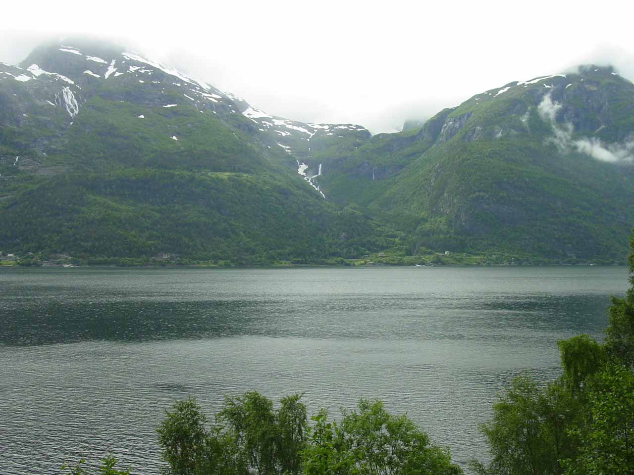 Contextual view towards another impressive waterfall looking across Sørfjorden