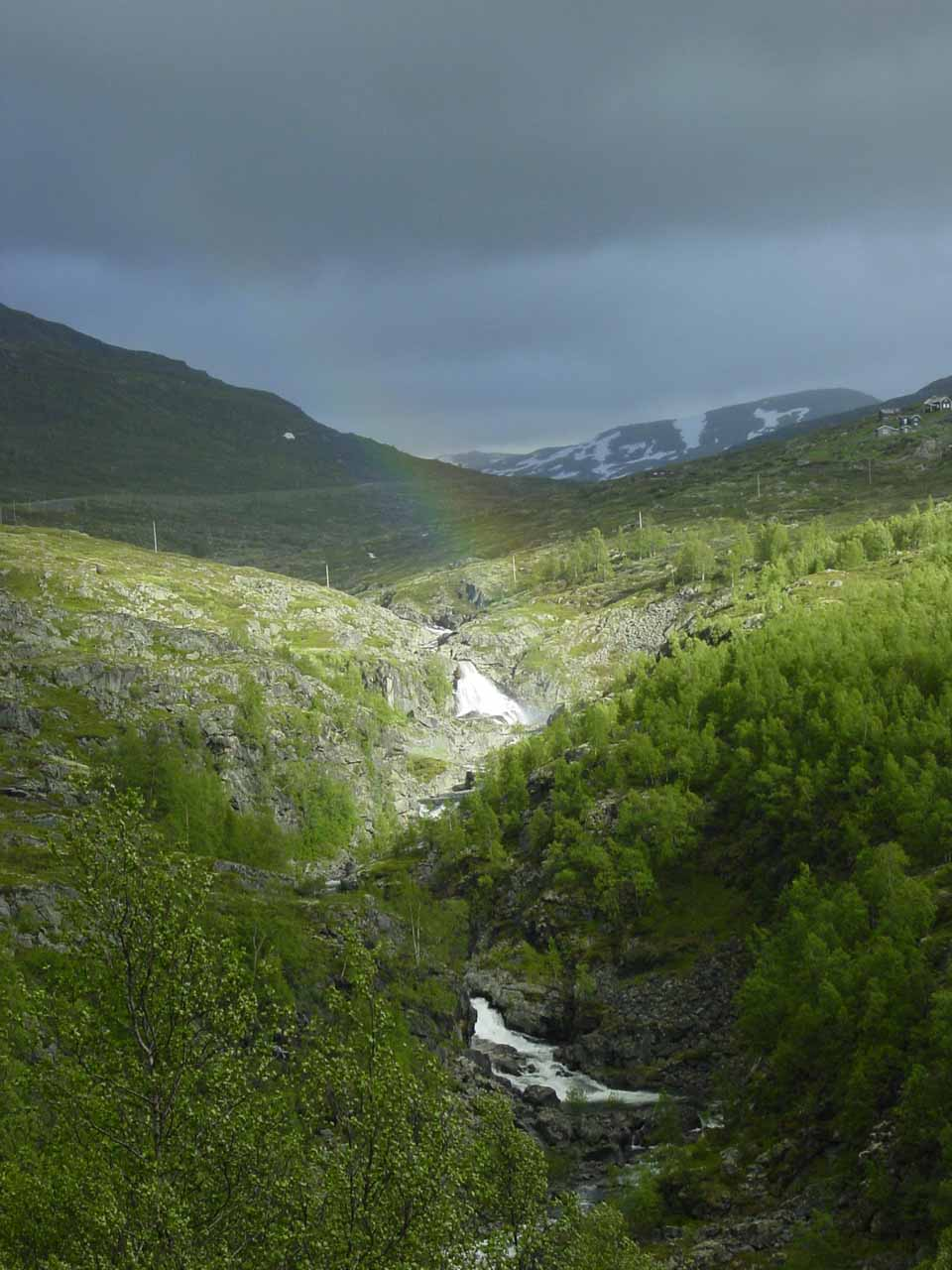 We noticed a rainbow arcing across this obscure pair of cascades while driving the Rv52 between Lærdal and Hemsedal