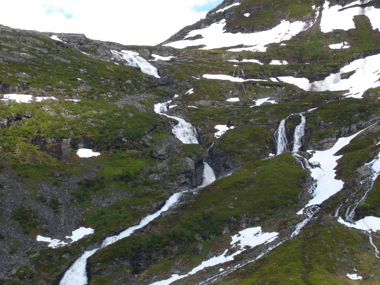 A closer afternoon view of the upper tiers of Kvanndalsfossen from the Road 63