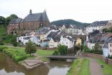 Saarburg_Waterfall_004_06182018 - Attractive view of the town of Saarburg, a canal outlet into the Mosel River, and a big church as seen from the road bridge over the Mosel River
