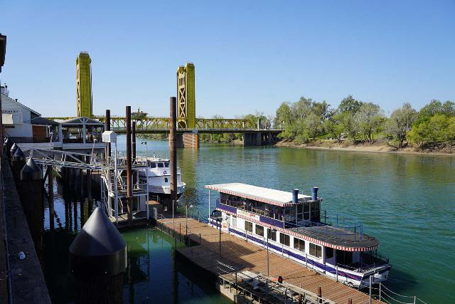 Sacramento_127_04102021 - It was about a 90-minute drive from the North Table Mountain Ecological Reserve to Sacramento. Shown here is the Sacramento River by the Old Sacramento looking towards the gold bridge paying homage to California's Gold Rush days