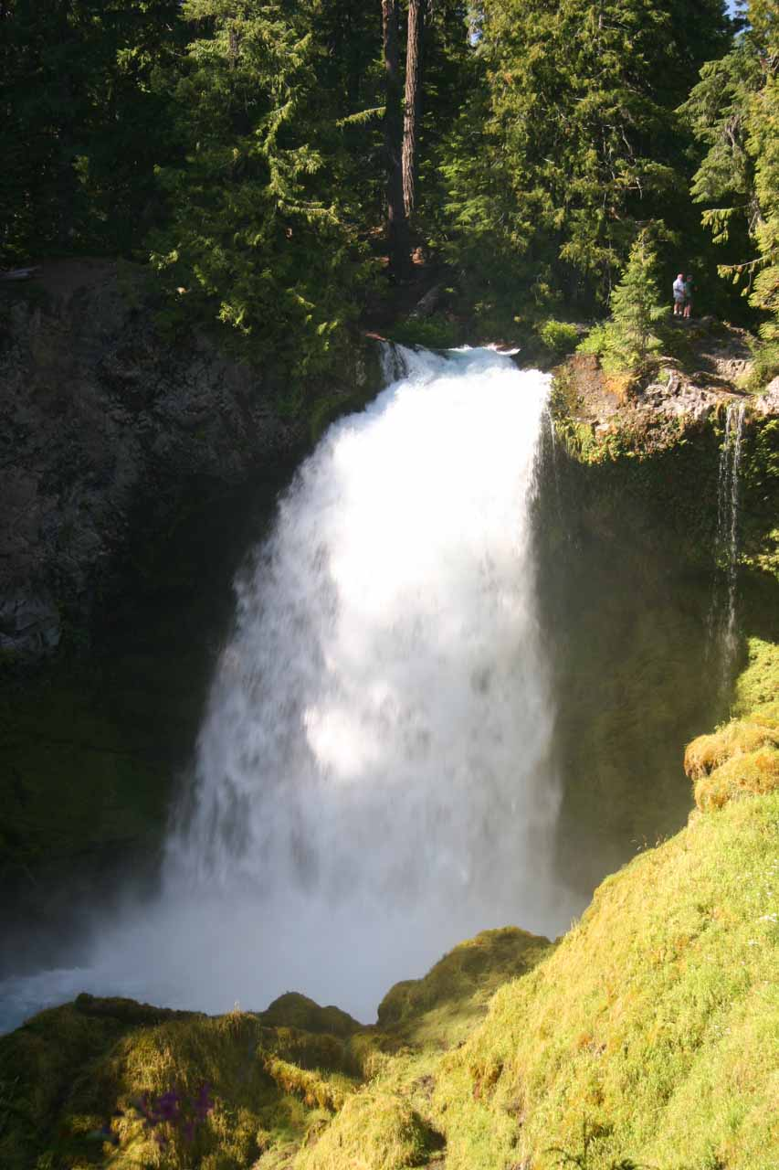 Closer look at Sahalie Falls with people near the top for a sense of scale