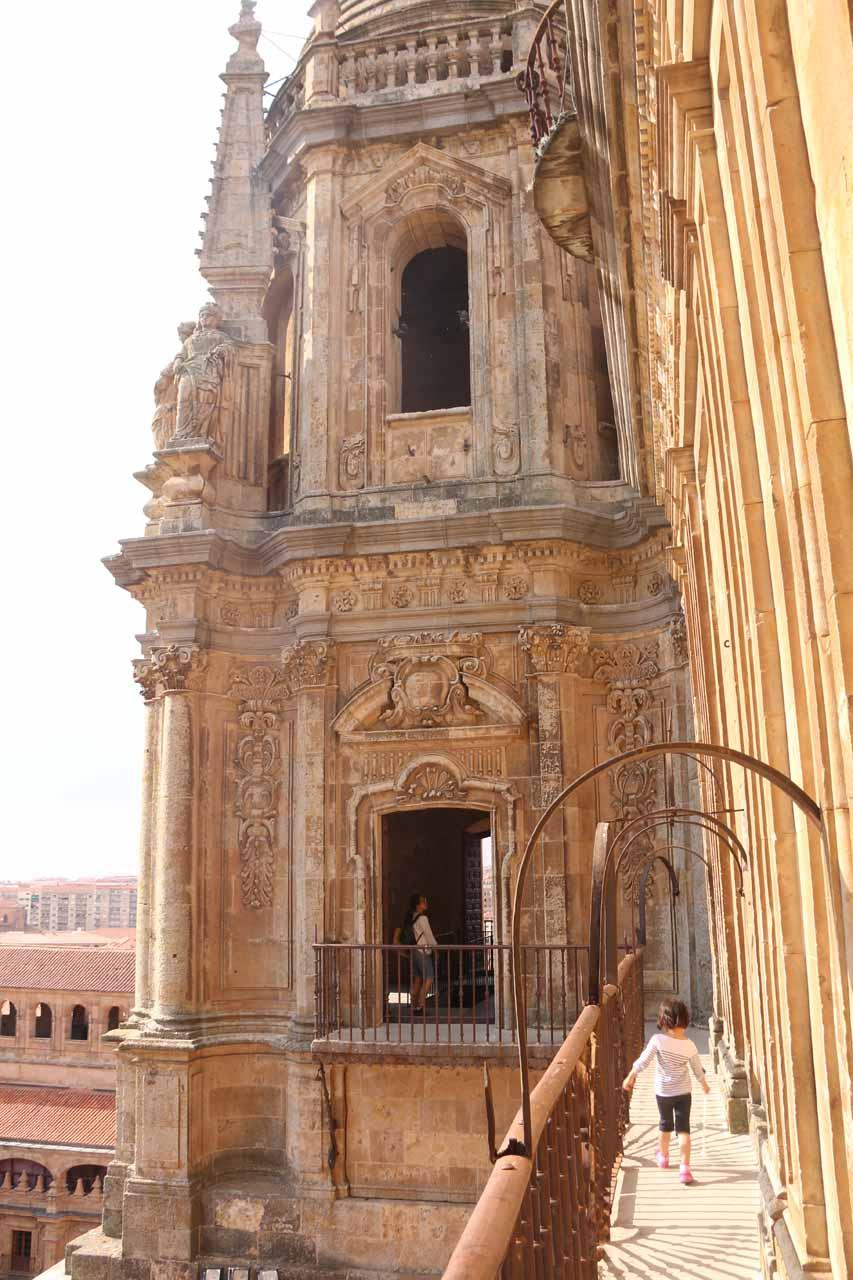 Tahia walking along the high ledge towards the adjacent tower at the Scala Coeli