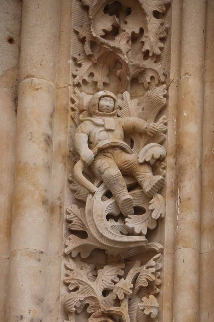 Checking out the astronaut by one of the side doors of the New Cathedral