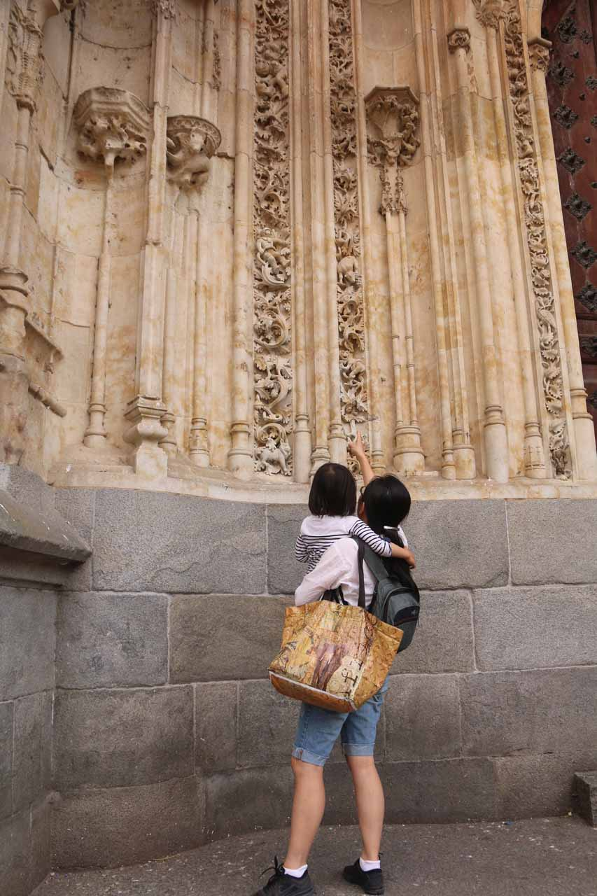 Context of Julie and Tahia checking out the funny engravings just outside the New Cathedral
