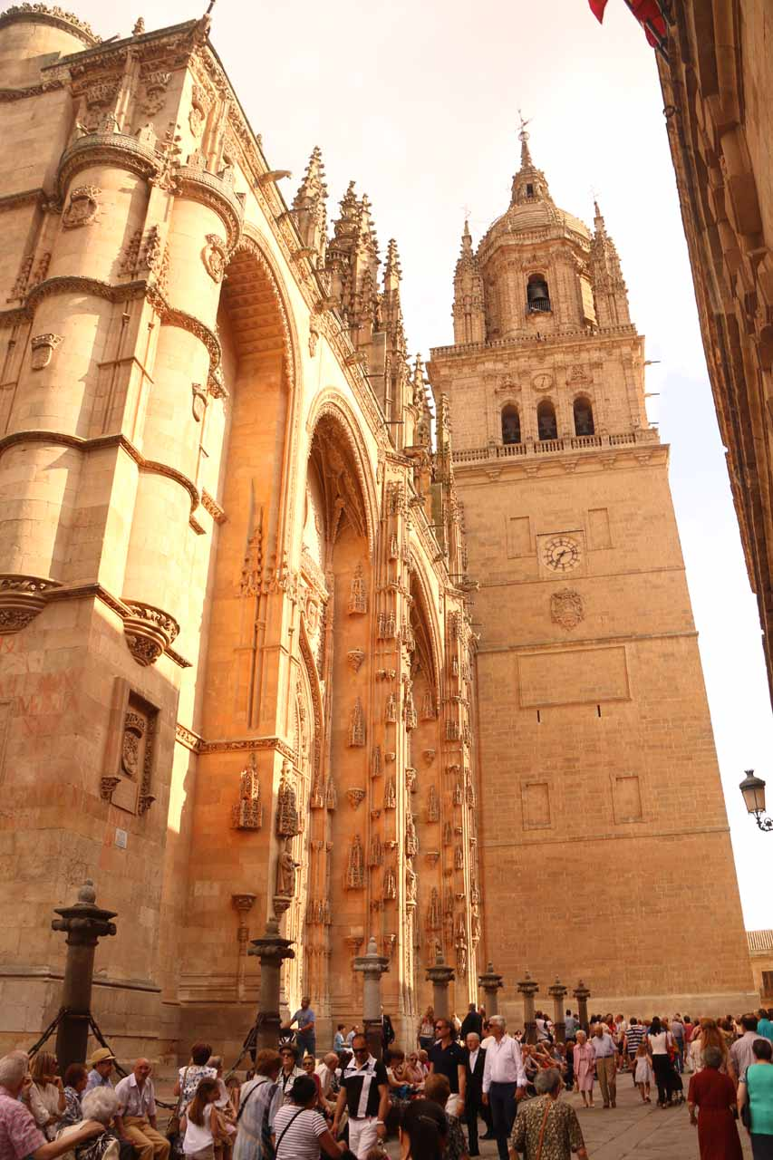 Looking towards the crowded front entrance and the bell tower of the New Cathedral in Salamanca