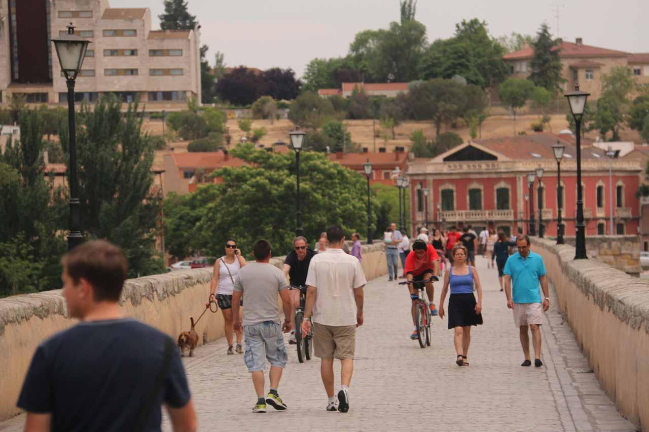 Walking on the busy Roman Bridge in Salamanca