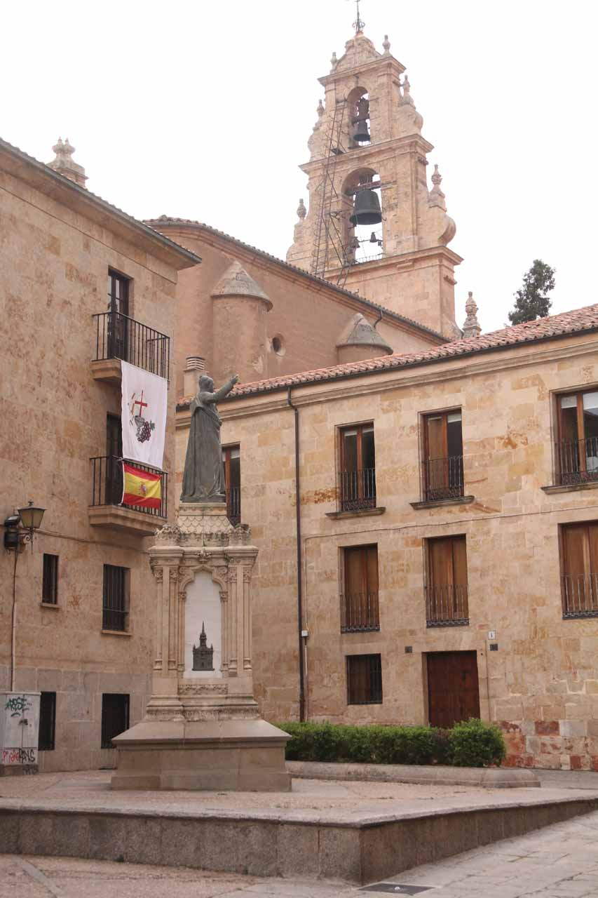 Looking towards a statue and some bells at Plaza Juan XXIII in Salamanca