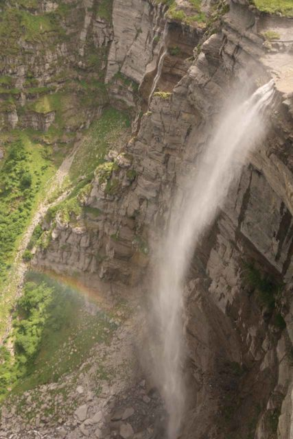 Salto_del_Nervion_060_06142015 - Momentarily looking down at almost the entire drop of the Salto del Nervión just when the sun came out enough to reveal a rainbow
