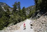 San_Antonio_Falls_045_05082020 - Julie and Tahia continuing further along the San Antonio Falls Road past the bend and on the final stretch leading to the San Antonio Falls lookout