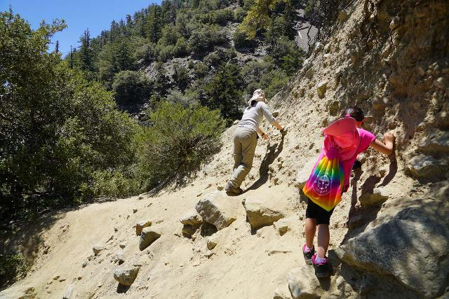 My wife and our daughter really relying on the traction of their shoes on a particularly eroded part of a trail