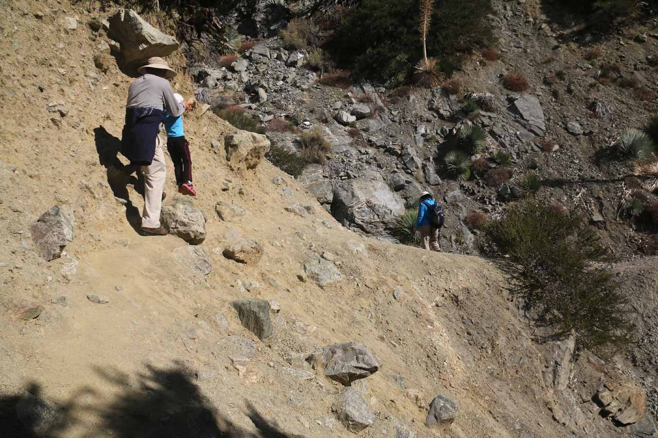 Dad and Tahia getting across the tricky eroded section of the base scramble