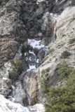 San_Antonio_Falls_16_070_01162016 - Contextual look at San Antonio Falls in early season flow with snow still around it in January 2016 and someone who managed to get all the way to the waterfall's base for a sense of scale
