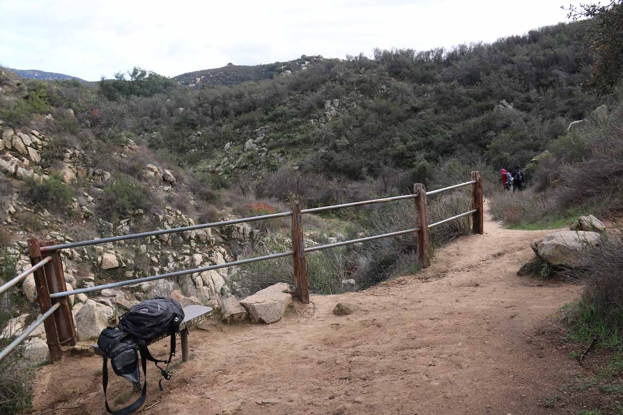 This railing marked the overlook of San Juan Falls, but to the right side was a trail leading down to the top of the waterfall, and to the left side was an informal trail-of-use to a ledge with the best view of the falls