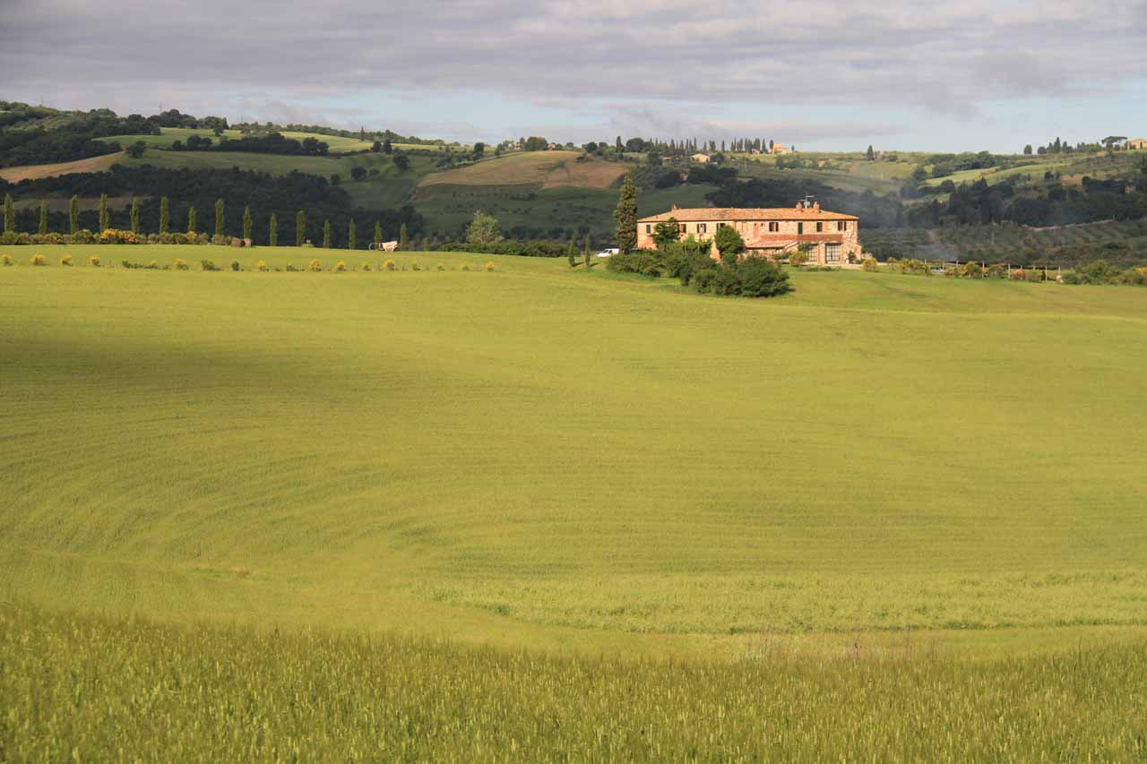 More rolling hills with patchy clouds as we looked towards the main building of our farm stay at Val d'Orcia
