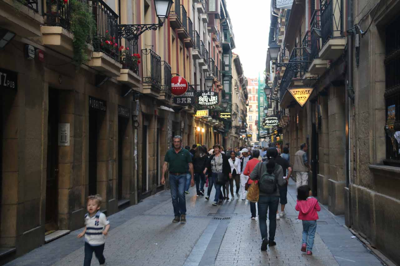 At a very busy part of the narrow streets of the Casco Viejo in San Sebastian during the paseo hour