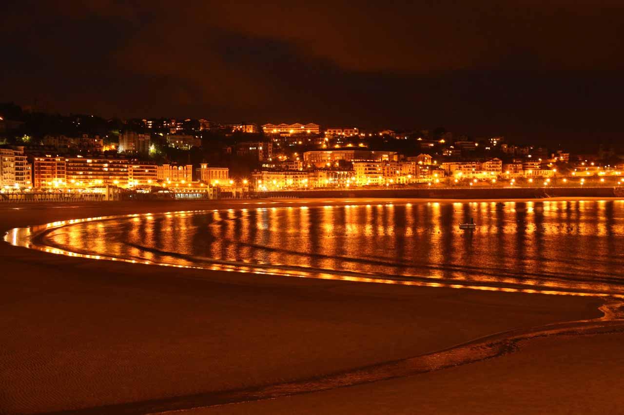 Strolling along the Playa de la Concha at night in San Sebastian